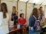 Signing books at Curious Arts